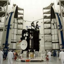 AEHF-2 Satellite Positioned Between Two Atlas V-Meter Fairings