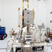 Team Members Inspect the Spacecraft Mate to the Payload Adapter