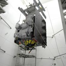 The Satellite Being Lifted onto the Encapsulation Stand