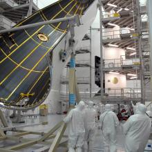 The Payload Fairings Being Moved into Position for Encapsulation