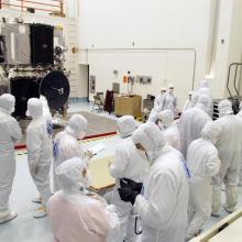 Technicians Inspecting the Spacecraft