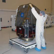 Preparing One of the Satellites for Inspections