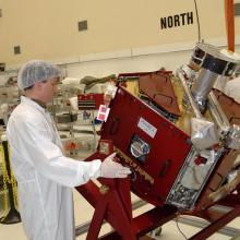 Inspecting One of the THEMIS Spacecraft