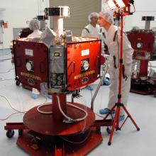 Technicians Inspect a Spacecraft