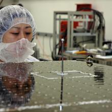 General Dynamics Technician Inspecting a Solar Array