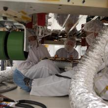 Technicians Carefully Position a High-Gain Antenna Under GLAST
