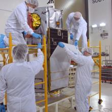 Technicians Inspecting and Testing OCO