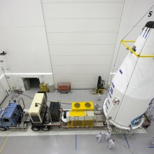 Fully Encapsulated in the Payload Fairing, TDRS-L is Placed Atop the Transporter