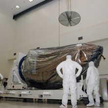 Workers Preparing the Spacecraft