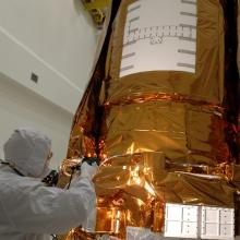 Workers Conduct a Light Sensor Test on NASA's Kepler Spacecraft