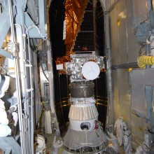 The First Half of the Fairing is Moved in Place Around the Spacecraft