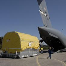 A Crew Offloads the Spacecraft from a C-17