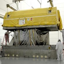 Inside Astrotech's Florida Facility, GOES-O is Removed from the Transport Container