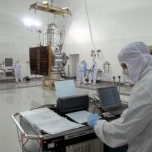 A Worker Monitors Data Received During the Lift