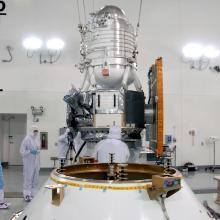 The Spacecraft Being Lifted Atop the Payload Attach Fitting