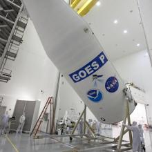 One of the Protective Fairing Halves Being Moved into Position to Encapsulate GOES-P