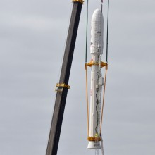 A Crane Lowers the Upper Stack Towards the Taurus XL Rocket's Stage 0