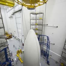 Preparing to Lift the Payload Fairing with JUNO onto the Transporter