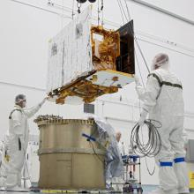 Technicians Lift the Spacecraft
