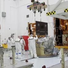 Technicians Lift the Spacecraft