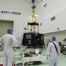 Lifting One of the Satellites onto a Work Stand