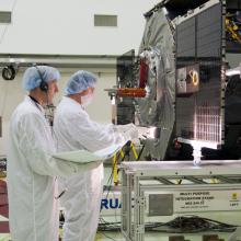 Technicians Inspecting the Twin Spacecraft