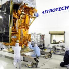 Technicians Processing the Spacecraft in One of Astrotech's Clean Rooms