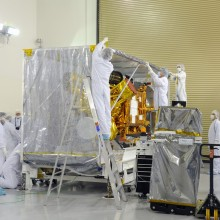 Workers Remove the Protective Blanket from the Spacecraft