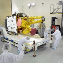 Engineers and Technicians Inspect the Spacecraft