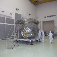 Workers Prepare to Remove the Protective Covering From Mini-stack #1