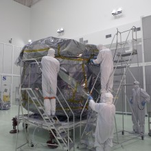 Technicians Begin to Remove the Covering From the Observatories