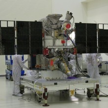 Engineers and Technicians Inspect the DSCOVR Spacecraft