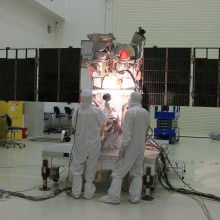 Workers Conduct a Light Test on the Solar Arrays