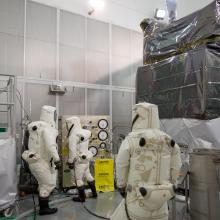 A Crew Begins Fueling the Spacecraft