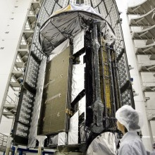 Technicians Work to Move Two Atlas V-Meter Fairings Around the Satellite