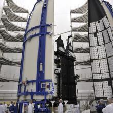 A Crew Works to Carefully Bring the Atlas V-Meter Fairings Together