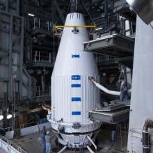 The Payload Fairing Being Mated to the Upper Section of the Rocket