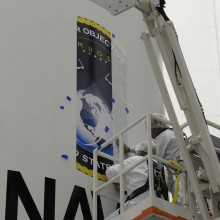 Technicians Adding the MUOS Logo onto the Atlas V Fairing