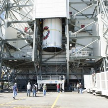The Satellite Being Lifted Atop a Delta IV Rocket